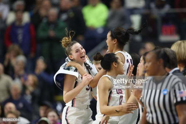 Katie Lou Samuelson of the Connecticut Huskies and Napheesa Collier of the Connecticut Huskies celebrate the teams win during the UConn Huskies Vs...