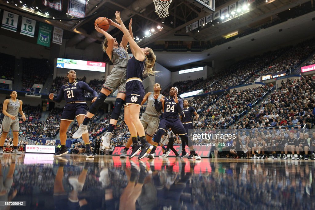 Katie Lou Samuelson #33 of the Connecticut Huskies drives to the basket defended by Marina Mabrey #3 of the Notre Dame Fighting Irish during the the UConn Huskies Vs Notre Dame, NCAA Women's Basketball game at the XL Center, Hartford, Connecticut. December 3, 2017