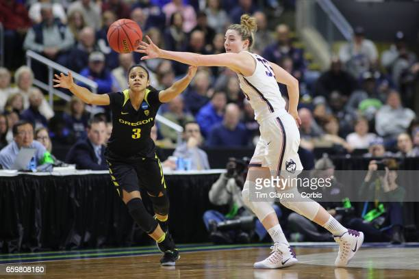Katie Lou Samuelson of the Connecticut Huskies makes a step watched by Justine Hall of the Oregon Ducks in action during the UConn Huskies Vs Oregon...