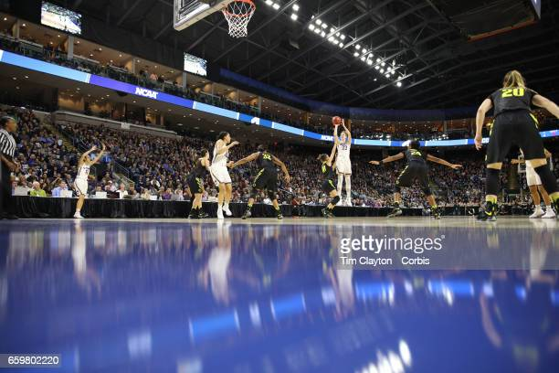 Katie Lou Samuelson of the Connecticut Huskies shoots for three defended by Lexi Bando of the Oregon Ducks during the UConn Huskies Vs Oregon Ducks...