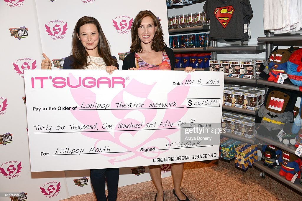 <a gi-track='captionPersonalityLinkClicked' href=/galleries/search?phrase=Katie+Lowes&family=editorial&specificpeople=5527804 ng-click='$event.stopPropagation()'>Katie Lowes</a> and Evelyn Iocolano attend the It'Sugar presents ceremonial check to actress and 'Scandal' star <a gi-track='captionPersonalityLinkClicked' href=/galleries/search?phrase=Katie+Lowes&family=editorial&specificpeople=5527804 ng-click='$event.stopPropagation()'>Katie Lowes</a> on behalf of The Lollipop Theater Network at It'Sugar on November 11, 2013 in Universal City, California.