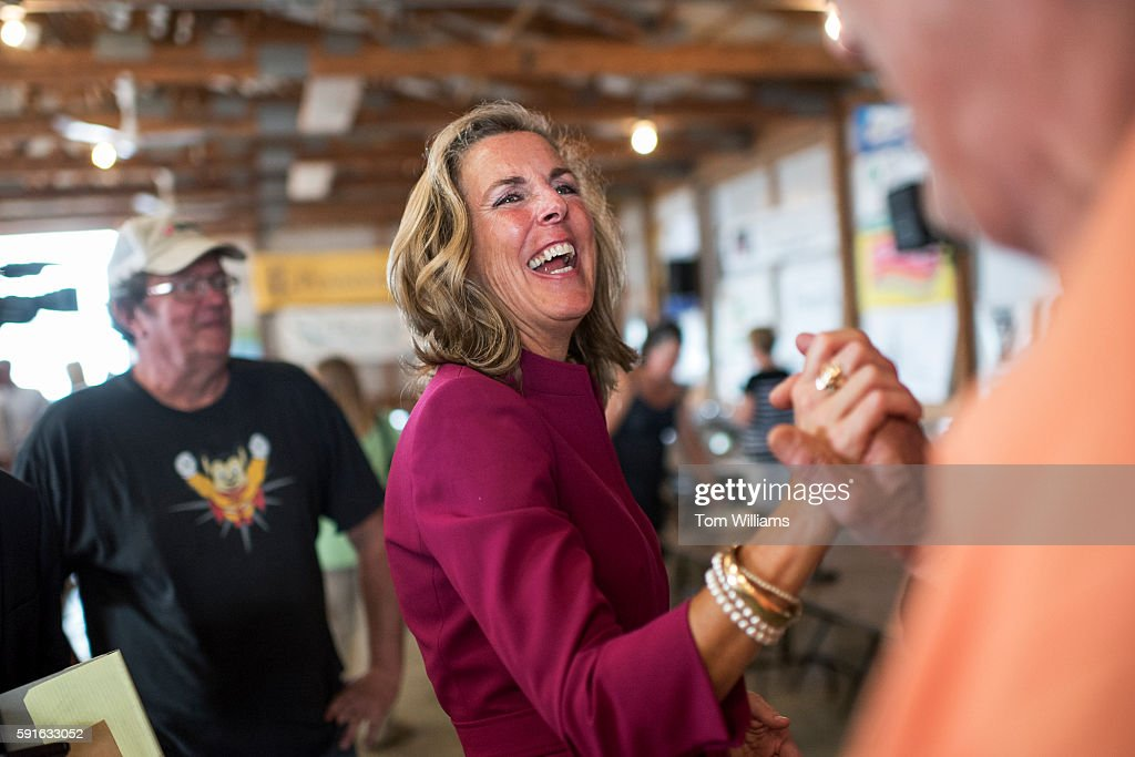 Katie McGinty Democratic candidate for Pennsylvania Senate talks with a guest during Penn State's Ag Progress Days in Pennsylvania Furnace Pa August...