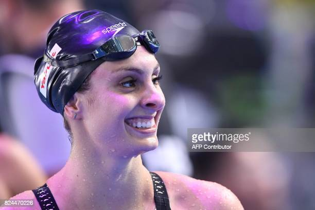 US Katie Meili reacts after competing in the final of the women's 50m breaststroke during the swimming competition at the 2017 FINA World...