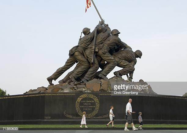 Katie Modeszto 4yearsold Tommy Modeszto 11yearsold and Jojo Modeszto 4yearsold accompany their parents on a walk around the Iwo Jima Memorial as the...