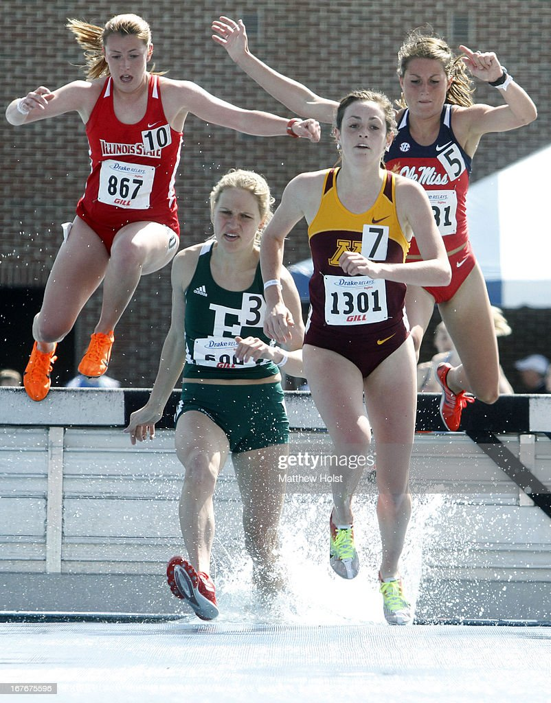 Katie Morazewski, of the Minnesota Gophers, Victoria Voronko, of the Eastern Michigan Eagles, Haley Cutright, of the Mississippi Rebels, and Elise Sigg of the Illinois State Redbirds, jump into the water obstacle competing in the Women's 3000-meter Steeplechase at the Drake Relays, on April 27, 2013 at Drake Stadium, in Des Moines, Iowa.