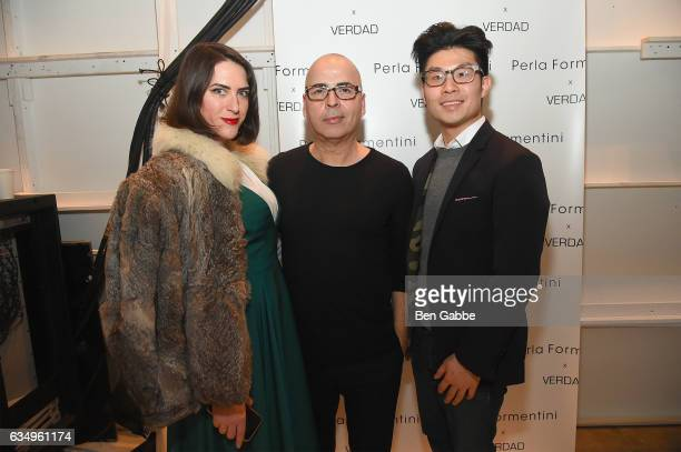 Katie Murphy Louis Verdad and Kenneth Ma pose backstage at the Verdad fashion show during New York Fashion Week at Pier 59 on February 12 2017 in New...