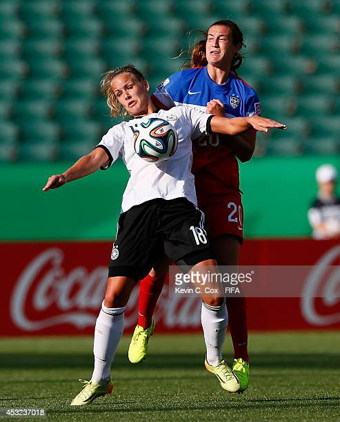 Katie Naughton of the United States challenges Lena Petermann of Germany at Commonwealth Stadium on August 5 2014 in Edmonton Canada