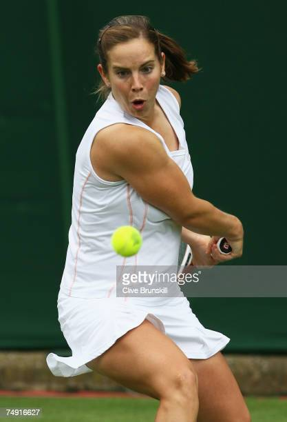 Katie O'Brien of Great Britain hits a backhand during the Women's Singles first round match against Sandra Kloesel of Germany during day two of the...