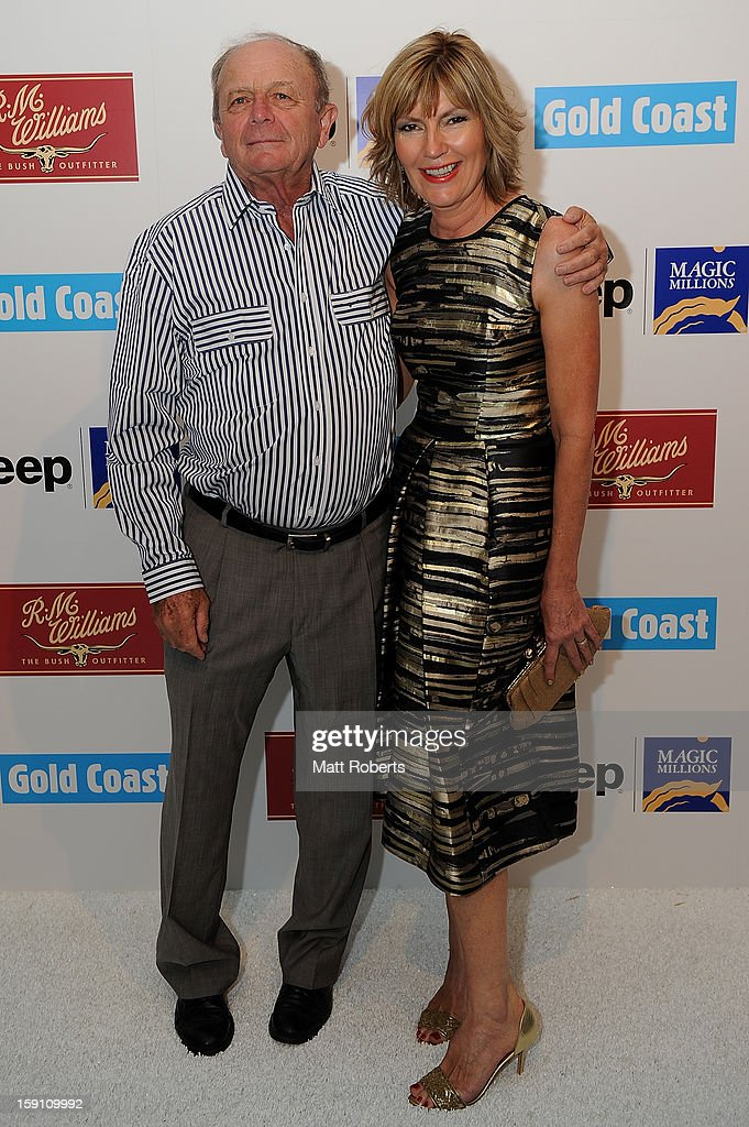 Katie Page-Harvey (R) and Gerry Harvey pose during the Magic Millions Opening Night cocktail party at Surfers Paradise foreshore on January 8, 2013 in Surfers Paradise, Australia.