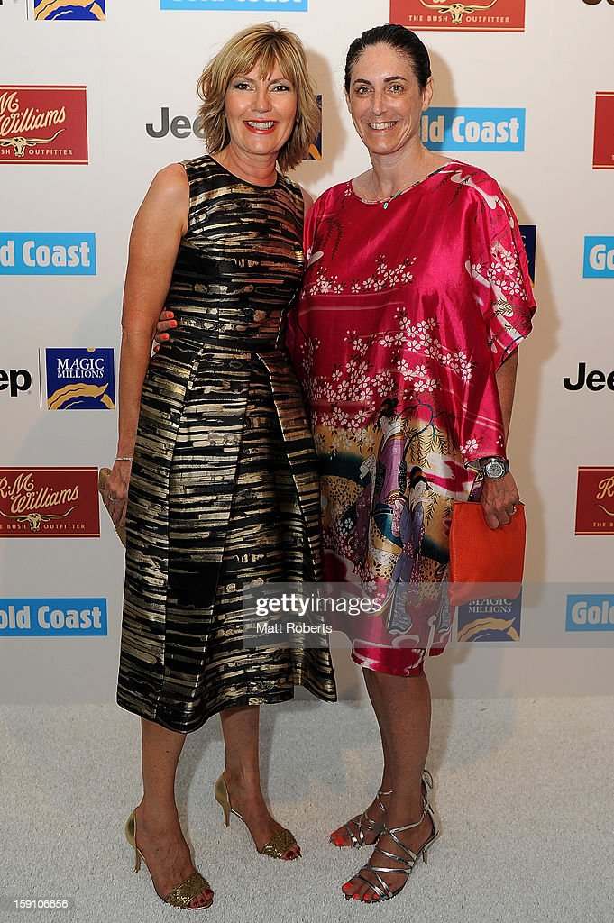 Katie Page-Harvey (L) and Jackie Frank pose during the Magic Millions Opening Night cocktail party at Surfers Paradise foreshore on January 8, 2013 in Surfers Paradise, Australia.
