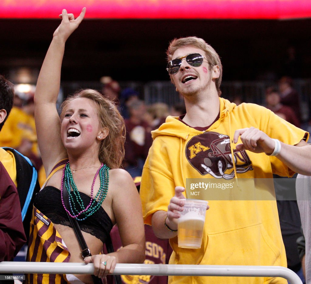 Katie Plunkett and Jordan Wing cheer on Minnesota during the first quarter against Texas Tech in the Meineke Car Care Bowl of Texas on Friday, December 28, 2012, at Reliant Stadium in Houston, Texas.