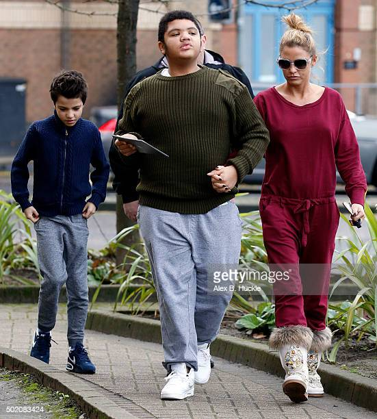 Katie Price arrives at the New Victoria Theatre with sons Harvey and Junior on December 20 2015 in Woking England