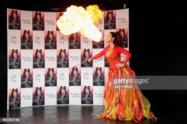 Katie Price spits fire at a photocall for her new novel 'Playing With Fire' at The Worx Studio's on October 17 2017 in London England