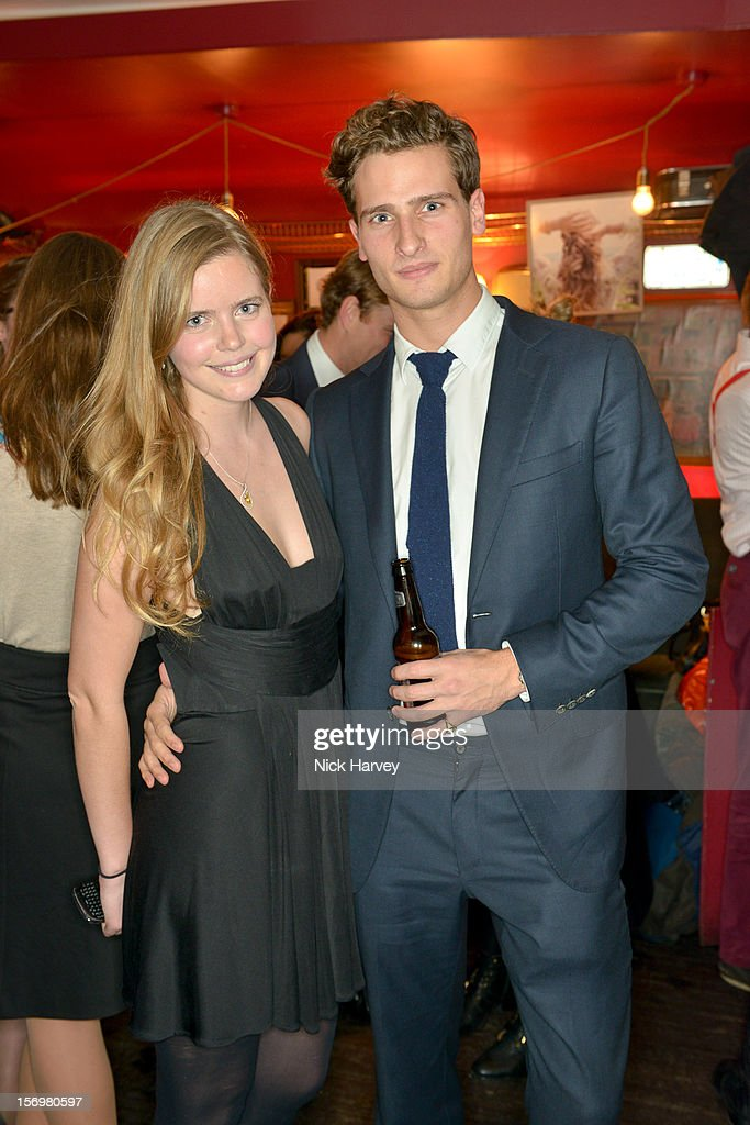 Katie Readman and Tom Warren attend a party to celebrate the best of W&W Jewellery at Barts bar on November 26, 2012 in London, England.