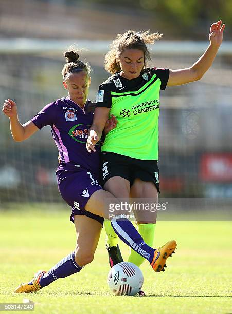 Katie Schubert of the Glory and Jenna McCormick of Canberra contest for the ball during the round 12 WLeague match between Perth Glory and Canberra...