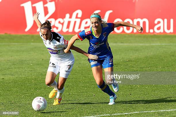 Katie Schubert of the Glory and Megan Oyster of the Jets contest for the ball during the round two WLeague match between Perth Glory and the...