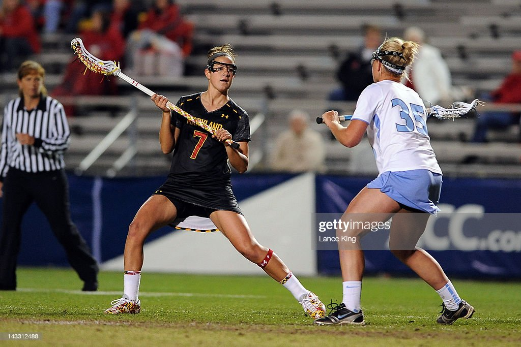Katie Schwarzmann #7 of the Maryland Terrapins looks to pass against Brittney Coppa #35 of the North Carolina Tar Heels during the finals of the 2012 Women's ACC Tournament at Koskinen Stadium on April 23, 2012 in Durham, North Carolina.