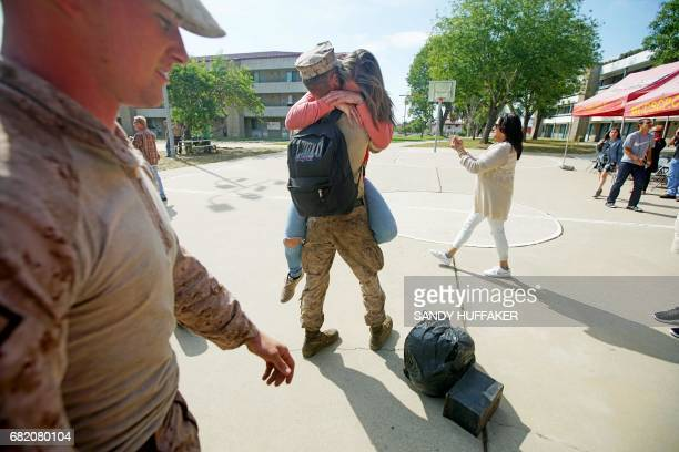 Katie Sciutto hugsher boyfrined Cpl Seth Peaton during a homecoming reception at Camp Pendleton in Oceanside California on May 11 2017 Marines and...