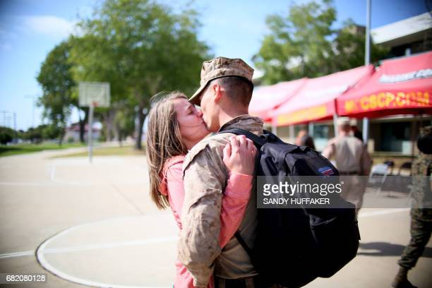 Katie Sciutto kisses her boyfrined Cpl Seth Peaton during a homecoming reception at Camp Pendleton in Oceanside California on May 11 2017 Marines and...