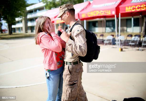 Katie Sciutto shares a moment with her boyfrined Cpl Seth Peaton during a homecoming reception at Camp Pendleton in Oceanside California on May 11...