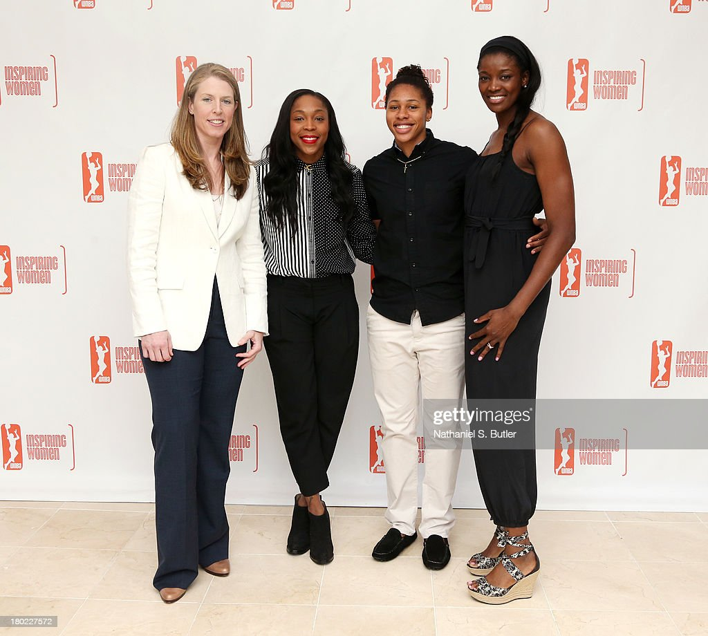 Katie Smith #30, Alex Montgomery #21, Cappie Pondexter #23 and DeLisha Milton-Jones #1 of the New York Liberty pose for a picture at the 2013 WNBA Inspiring Women's Luncheon in New York City.
