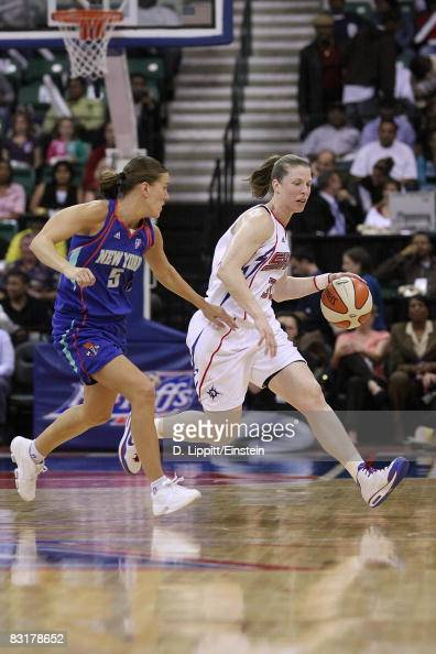 Katie Smith of the Detroit Shock drives the ball against Erin Thorn of the New York Liberty in Game Three of the Eastern Conference Finals during the...