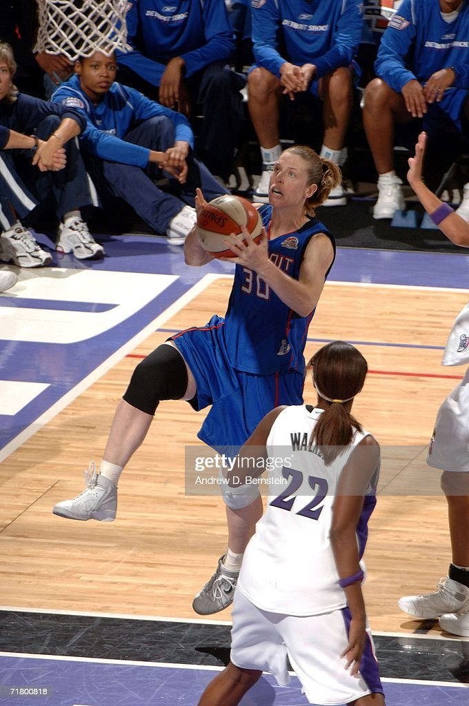 Katie Smith of the Detroit Shock drives to the basket against DeMya Walker of the Sacramento Monarchs during Game Four of the 2006 WNBA Finals on...