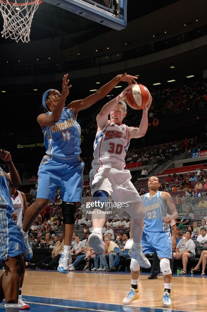 Katie Smith of the Detroit Shock grabs a rebound under pressure against Jia Perkins of the Chicago Sky during the WNBA game on July 16 2008 at The...