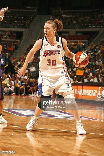 Katie Smith of the Detroit Shock looks to pass against the Sacramento Monarchs during Game Two of the 2006 WNBA Finals September 1 2006 at the Palace...