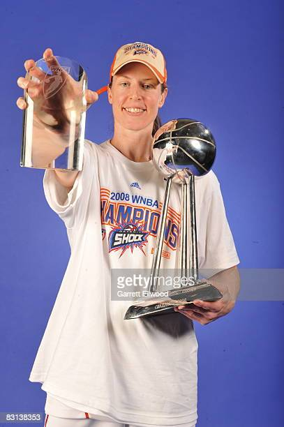 Katie Smith of the Detroit Shock poses for a portrait with her MVP and Championship Trophies after winning Game Three of the WNBA Finals against the...