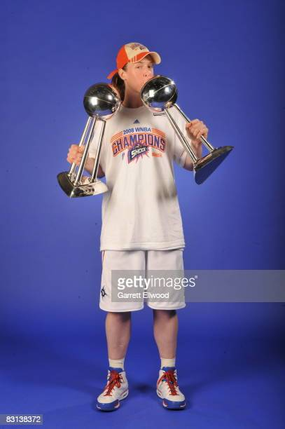 Katie Smith of the Detroit Shock poses for a portrait with the Championship Trophies after winning Game Three of the WNBA Finals against the San...