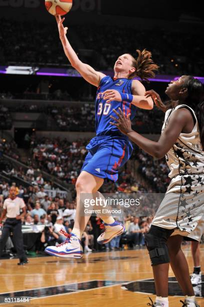 Katie Smith of the Detroit Shock shoots against Sophia Young of the San Antonio Silver Stars in Game Two of the WNBA Finals on October 3 2008 at ATT...