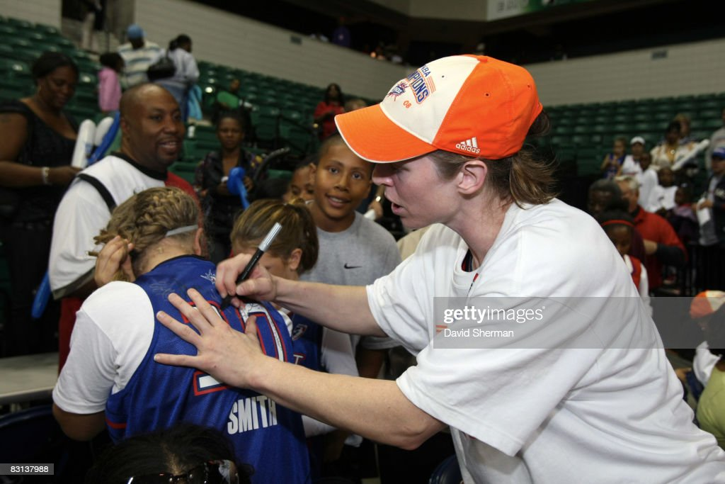 Katie Smith of the Detroit Shock signs an autograph after winning Game Three of the WNBA Finals against the San Antonio Silver Star on October 5 2008...