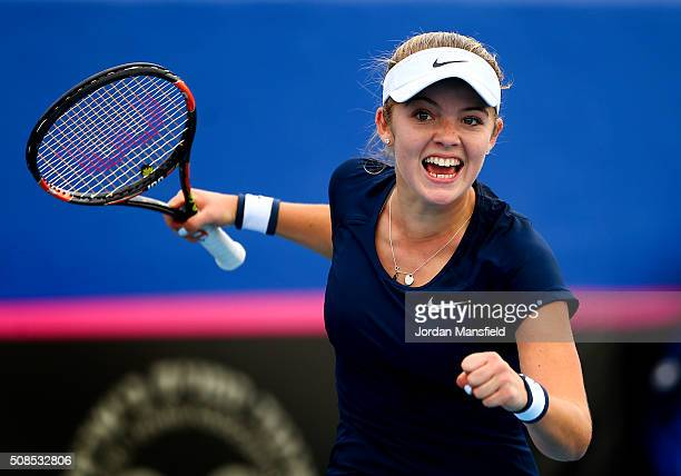 Katie Swan of Great Britain celebrates winning her match against Ekaterine Gorgodze of Georgia during the tie between Georgia and Great Britain on...