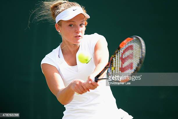 Katie Swan of Great Britain in action against Tamira Paszek of Austria in the Ladies Second Round match during the 2015 Wimbledon Qualifying Session...