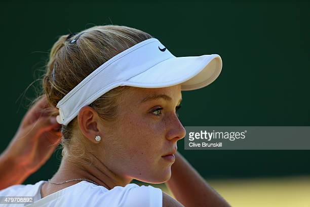 Katie Swan of Great Britain looks on in her Girl's Singles First Round match against Seone Mendes of Australia during day seven of the Wimbledon Lawn...