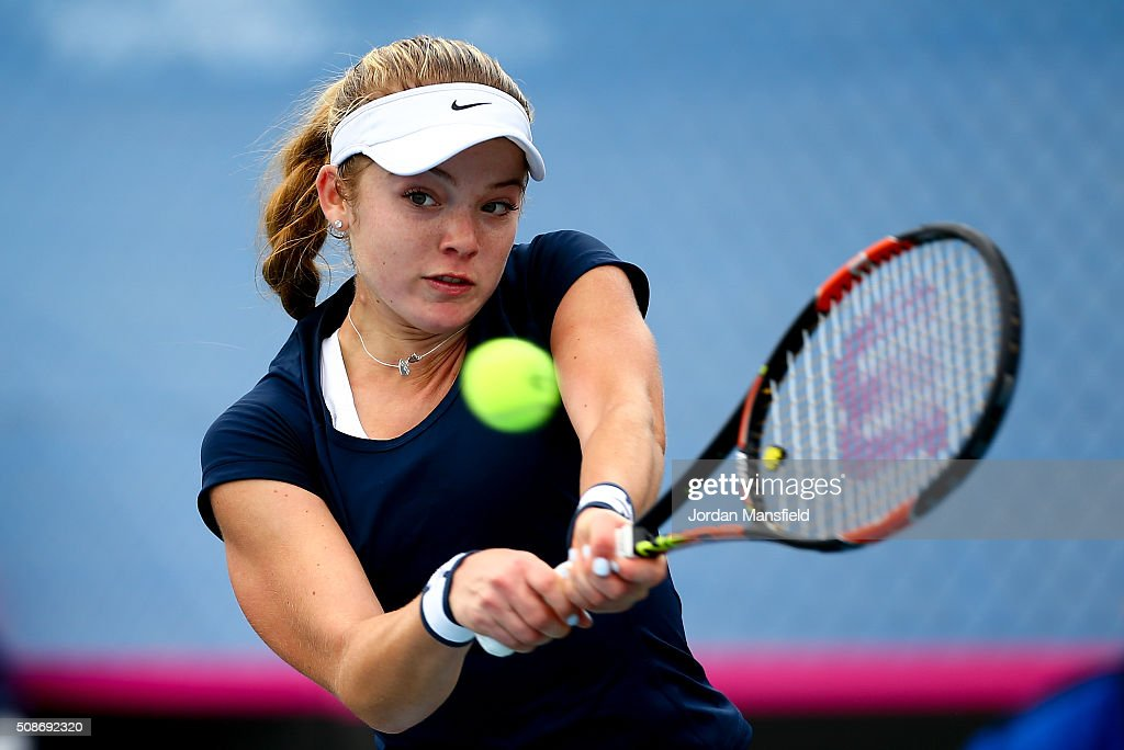 <a gi-track='captionPersonalityLinkClicked' href=/galleries/search?phrase=Katie+Swan&family=editorial&specificpeople=12941359 ng-click='$event.stopPropagation()'>Katie Swan</a> of Great Britain plays a backhand during her match against Ysaline Bonaventure during the tie between Belgium and Great Britain on day three of the Fed Cup Europe/Africa Group One fixture at the Municipal Tennis Club on February 6, 2016 in Eilat, Israel.