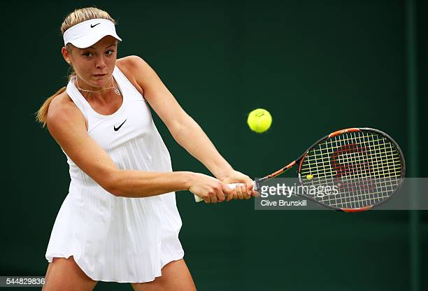 Katie Swan of Great Britain plays a backhand during the Girl's singles first round match against Mariam Bolkvadze of Georgia on day seven of the...