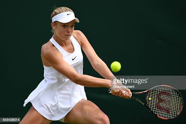 Katie Swan of Great Britain plays a backhand during the Ladies Singles first round match against Timea Bacsinszky of Switzerland on day two of the...