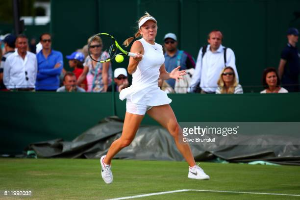 Katie Swan of Great Britain plays a forehand during the Girl's Singles first round match against Lara Schmidt of Germany on day seven of the...