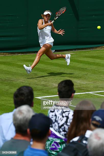 Katie Swan of Great Britain plays a forehand during the Ladies Singles first round match against Timea Babos of Hungary on day two of the Wimbledon...