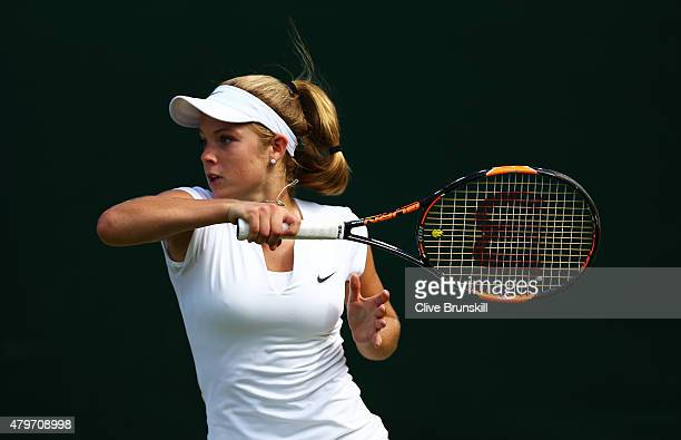 Katie Swan of Great Britain returns a shot in her Girl's Singles First Round match against Seone Mendes of Australia during day seven of the...