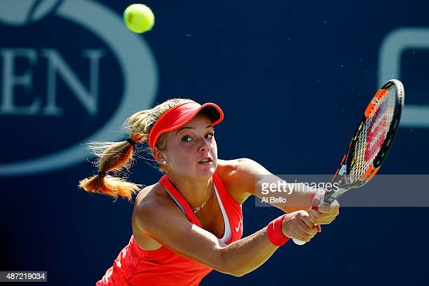Katie Swan of Great Britain returns a shot to Tessah Andrianjafitrimo of France Junior Girls' Singles First Round match on Day Eight of the 2015 US...