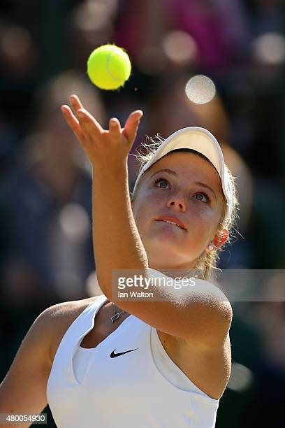 Katie Swan of Great Britain serves in her Girls Singles match against Viktoria Kuzmova of Slovakia during day ten of the Wimbledon Lawn Tennis...