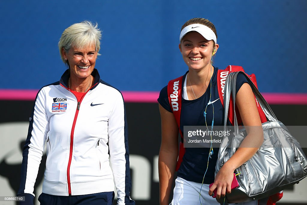 <a gi-track='captionPersonalityLinkClicked' href=/galleries/search?phrase=Katie+Swan&family=editorial&specificpeople=12941359 ng-click='$event.stopPropagation()'>Katie Swan</a> of Great Britain (R) walks onto court with captain <a gi-track='captionPersonalityLinkClicked' href=/galleries/search?phrase=Judy+Murray&family=editorial&specificpeople=582324 ng-click='$event.stopPropagation()'>Judy Murray</a> (L) ahead of her match against Ysaline Bonaventure during the tie between Belgium and Great Britain on day three of the Fed Cup Europe/Africa Group One fixture at the Municipal Tennis Club on February 6, 2016 in Eilat, Israel.