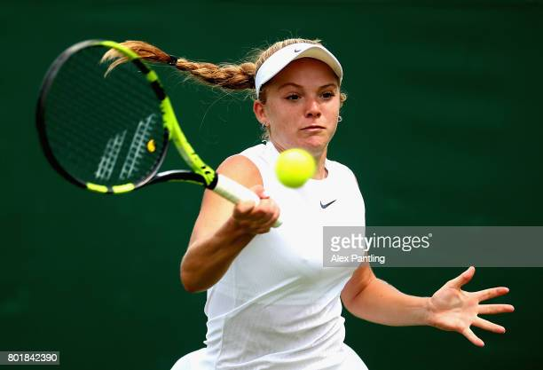 Katie Swann of Great Britain in action during the ladies singles qualifying match against Nigina Abduraimova of Uzbekistan duirng the 2017 Wimbledon...