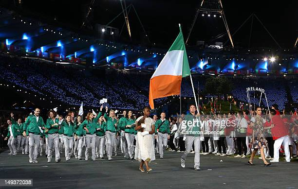 Katie Taylor of the Irland Olympic boxing team carries her country's flag during the Opening Ceremony of the London 2012 Olympic Games at the Olympic...