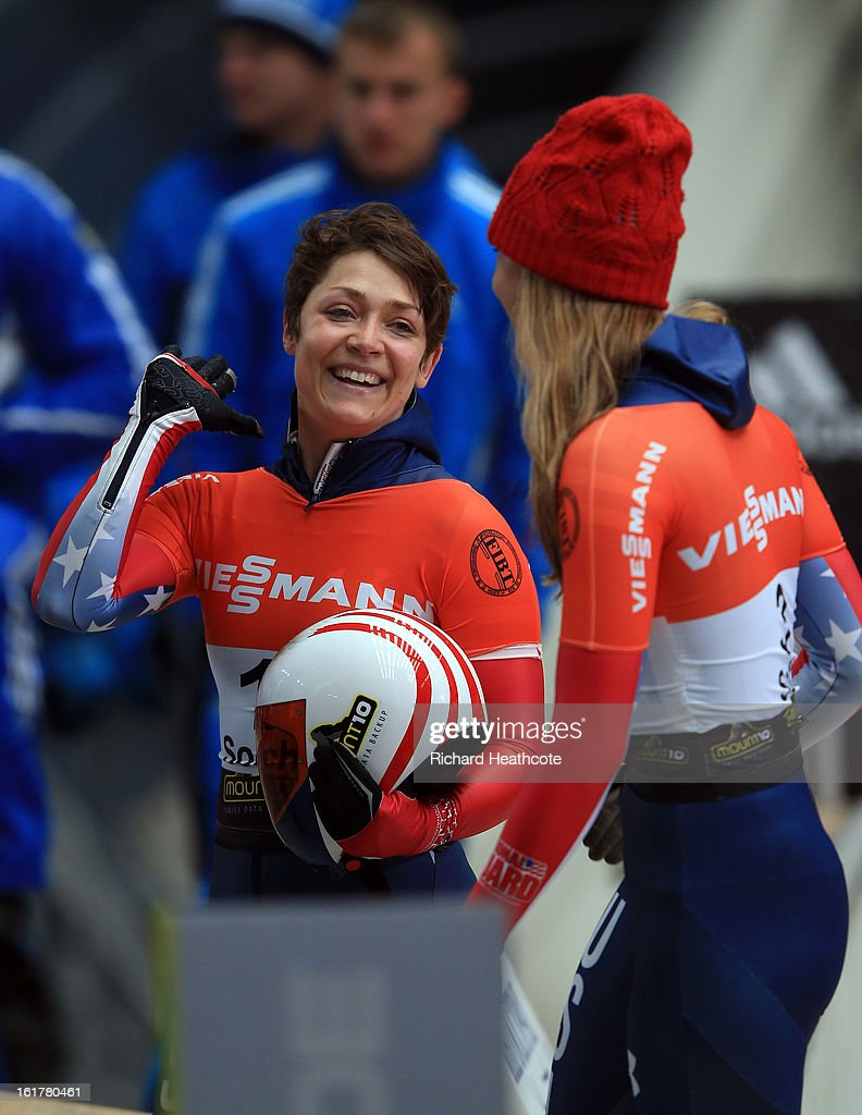 Katie Uhlaender #1 and Noelle Pikus-Pace #3 of the USA embrace at the finish after taking 1st and 2nd in the Women's Skeleton Viessman FIBT Bob & Skeleton World Cup at the Sanki Sliding Center in Krasnya Polyana on February 16, 2013 in Sochi, Russia. Sochi is preparing for the 2014 Winter Olympics with test events across the venues.