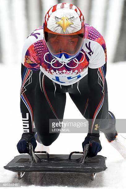 US Katie Uhlaender finishes her run during the Women's Skeleton Heat 3 of the Sochi Winter Olympics on February 14 2014 at the Sanki Sliding Center...