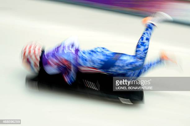 US Katie Uhlaender takes part in a Women's Skeleton official training during the Sochi Winter Olympics on February 11 2014 at the Sanki Sliding...
